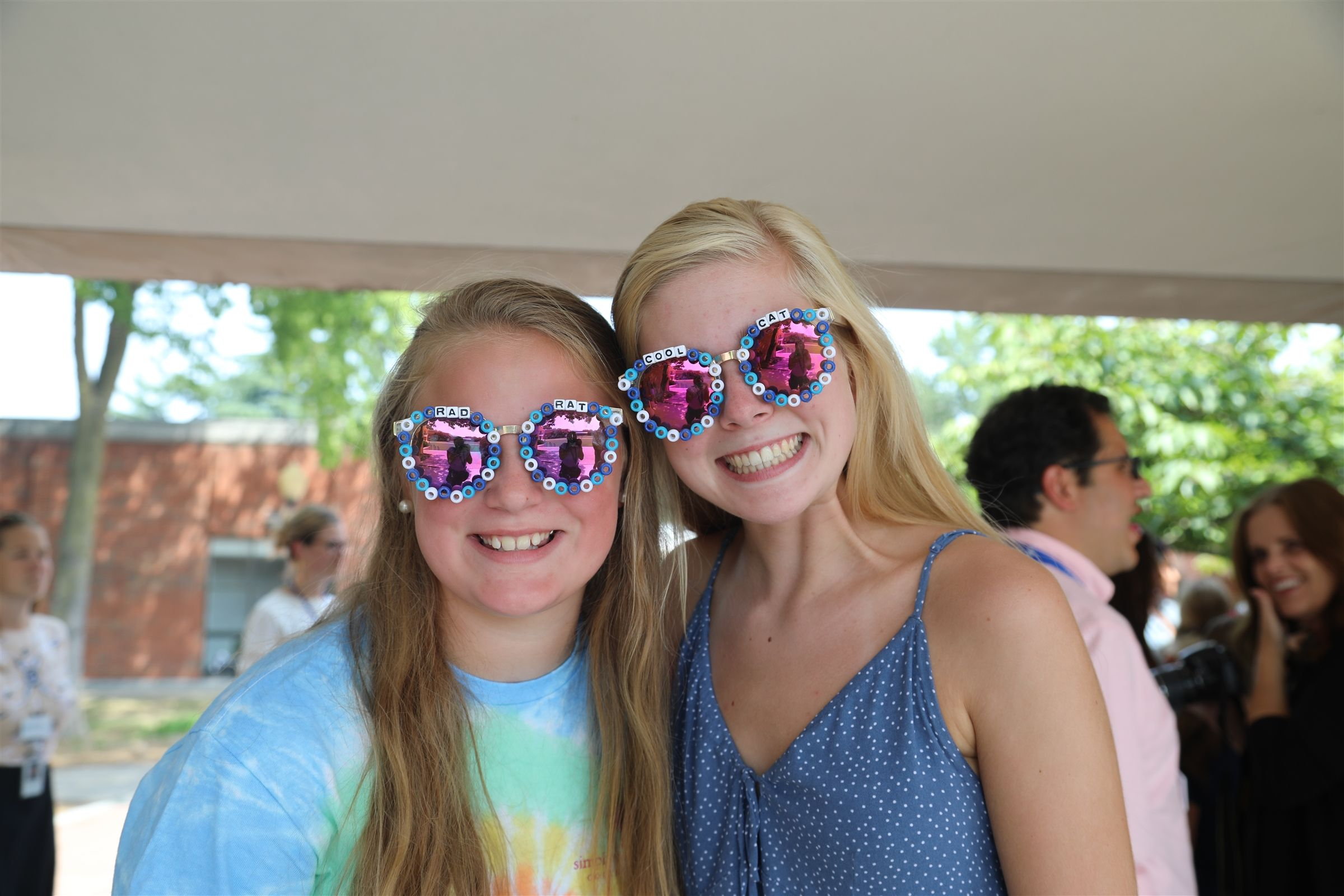 Two GPS girls wearing fun sunglasses at a Cat-Rat event