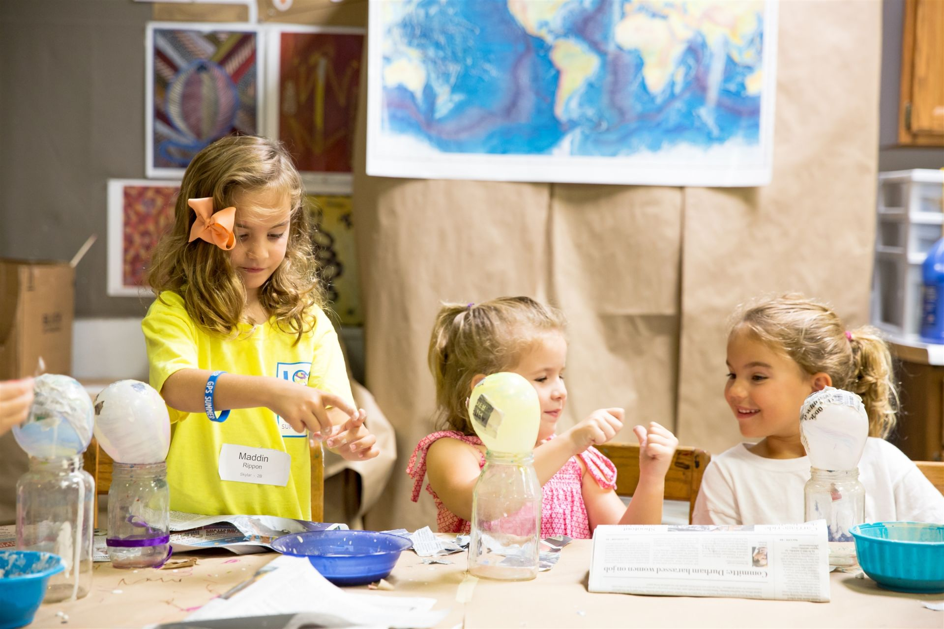 Three girls working on crafts at GPS Summer Camp