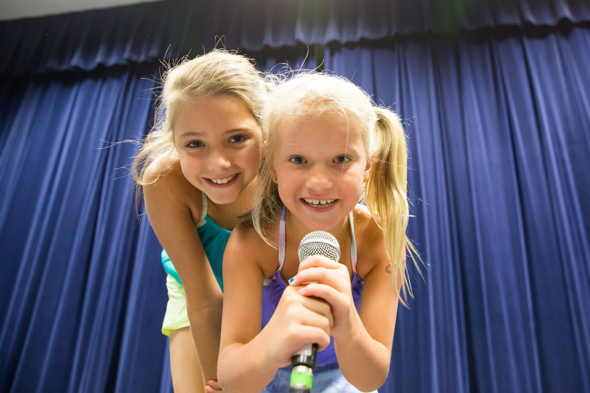 Two girls with microphone at GPS Summer Camp
