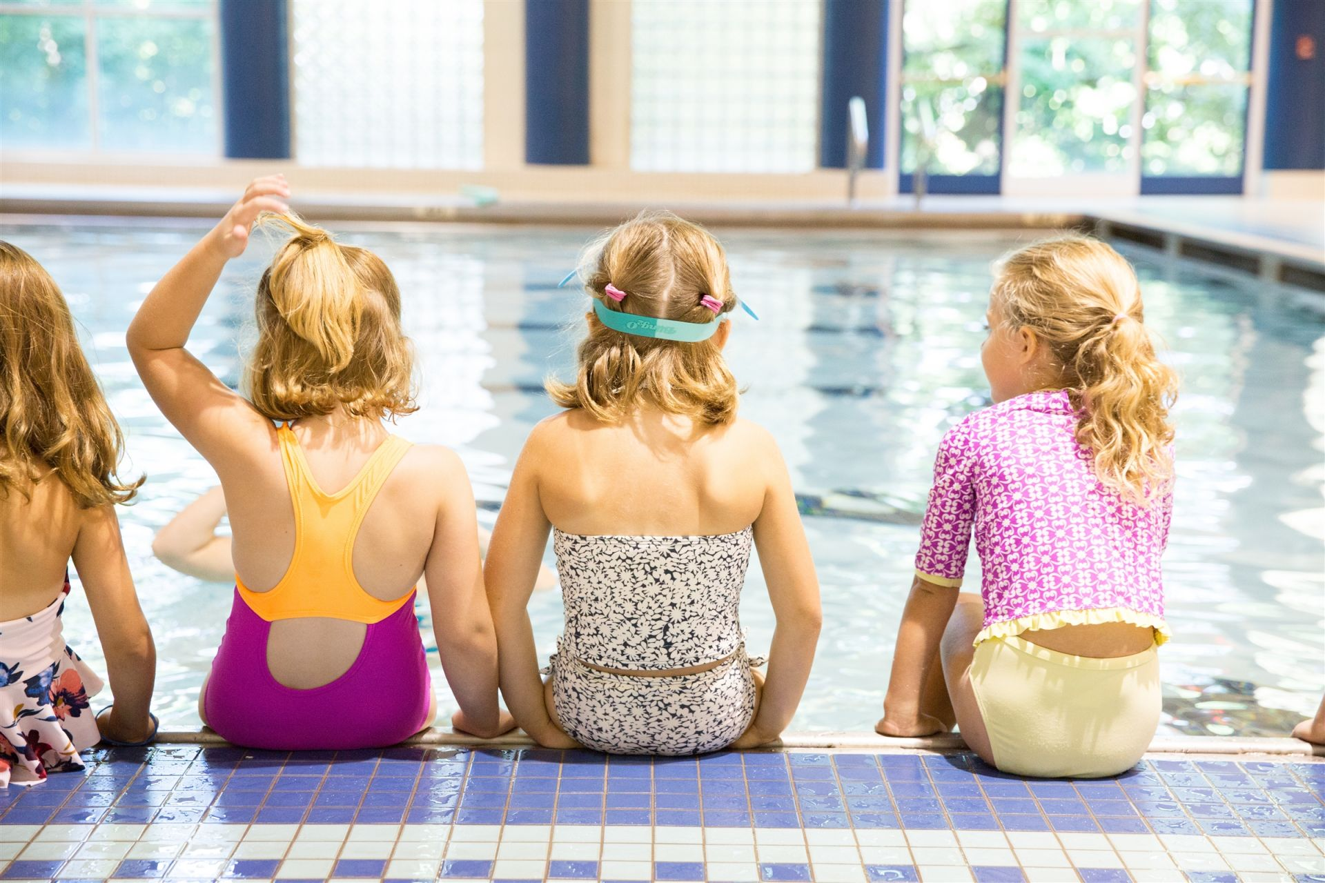 Group of girls on edge of pool at GPS Summer Camp