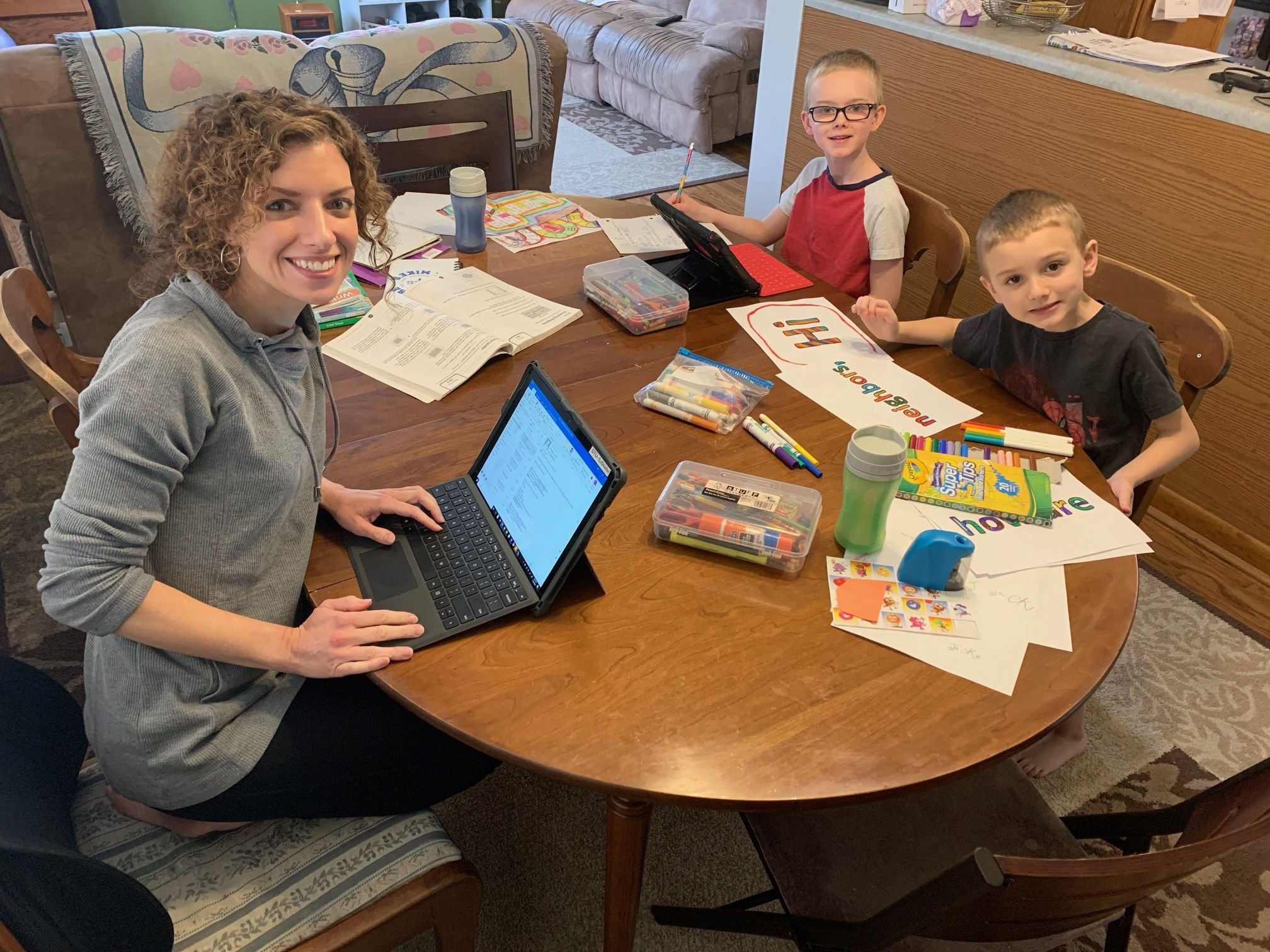 Teacher working from home and E-learning with her children
