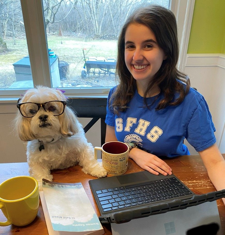 Female student and her dog during E-learning