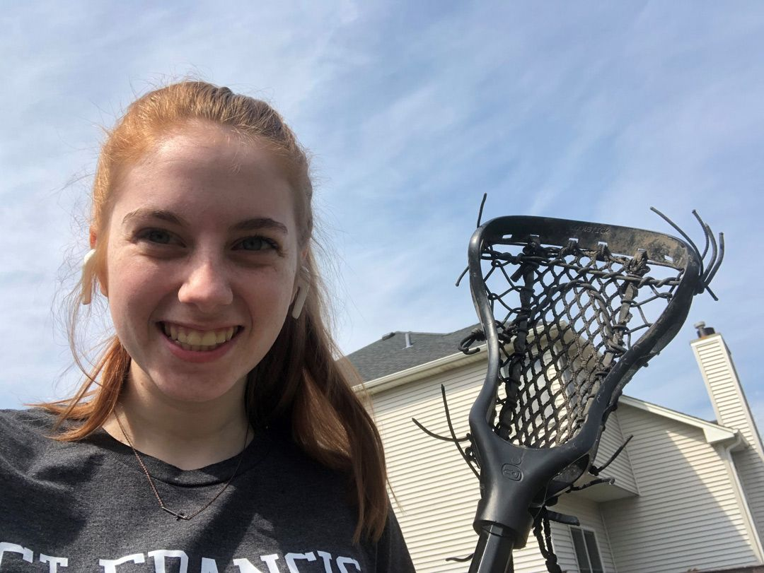 Female student with a lacrosse stick