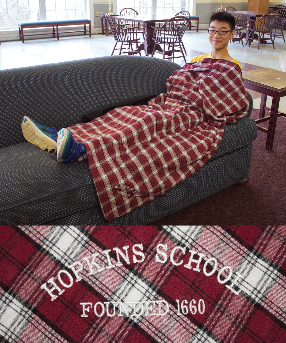 A generously sized flannel blanket, very soft.  Matches our PJ pants, garnet plaid flannel on one side, soft black fleece on the order.  $45.00