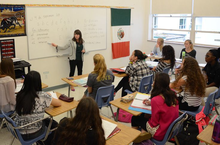 A Spanish class listens intently as Ms. Leen introduces a new concept.