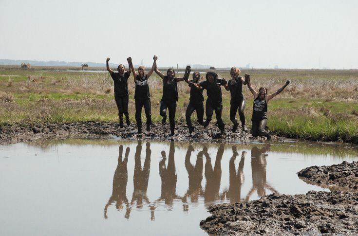 Grier students boldly jump in the mud at Wallops Island.