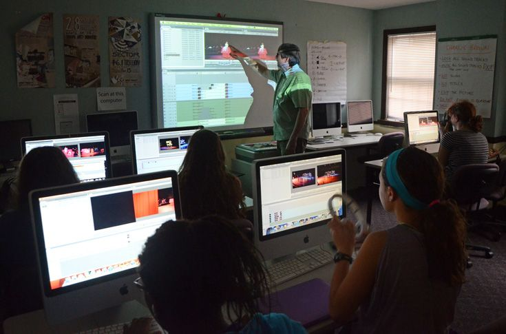 Students learn to use video editing software in Digital Video Production.