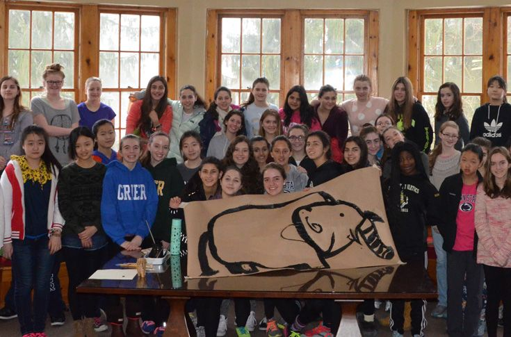 Grier promotes wellness through events such as this Health and Wellness Day. Here, a group of students used serious teamwork to create an image of an elephant one brush stroke at a time.