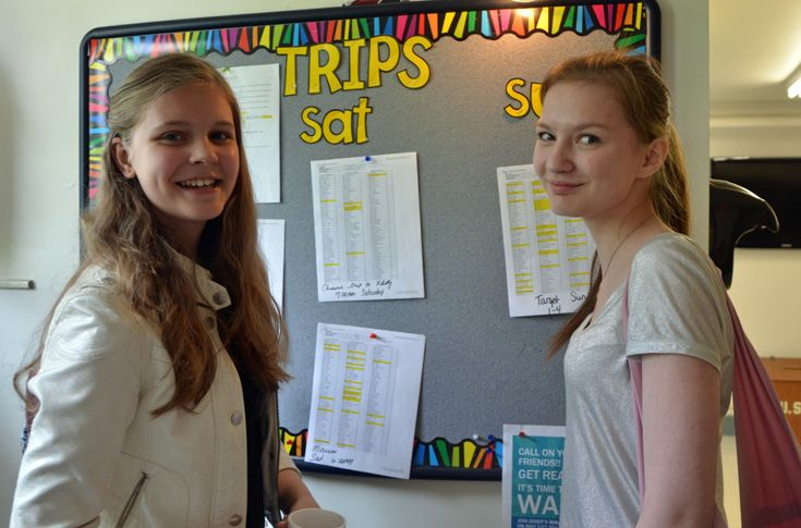 Students sign-up for weekend activities on the bulletin board outside the Bookstore.