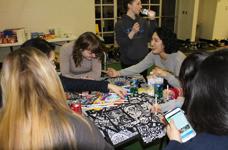 Students don't always need to travel away from Grier for a good time. There is plenty of fun to be had during weekends on the Grier campus. Here, some students laugh as they color together during a lock-in night in the Gym.