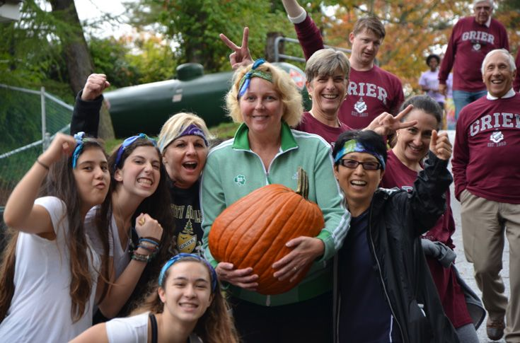 Faculty, Board Members, and students team up to raise money for charity during the NHS Walk-a-thon. The event includes a spirited competition between groups of students and faculty. Here, someone has slowed down Mrs. Davis with a large pumpkin!
