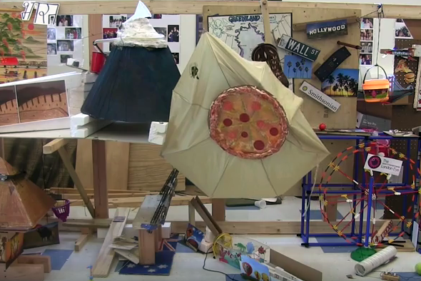 An international-themed, collaborative Rube-Goldberg machine.