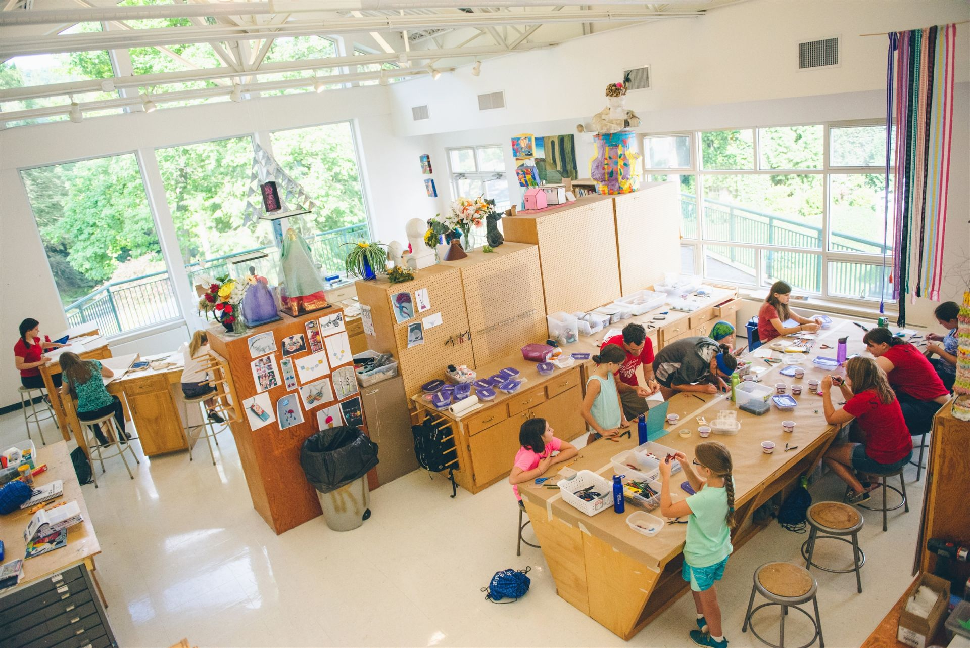 The art building is designed to inspire creativity within our campers. From its multitude of windows which shower the space with natural light to the 4 separate group work areas, campers and instructors create side by side. Summer art classes in painting/drawing, jewelry, printmaking, and mixed media typically occur here.