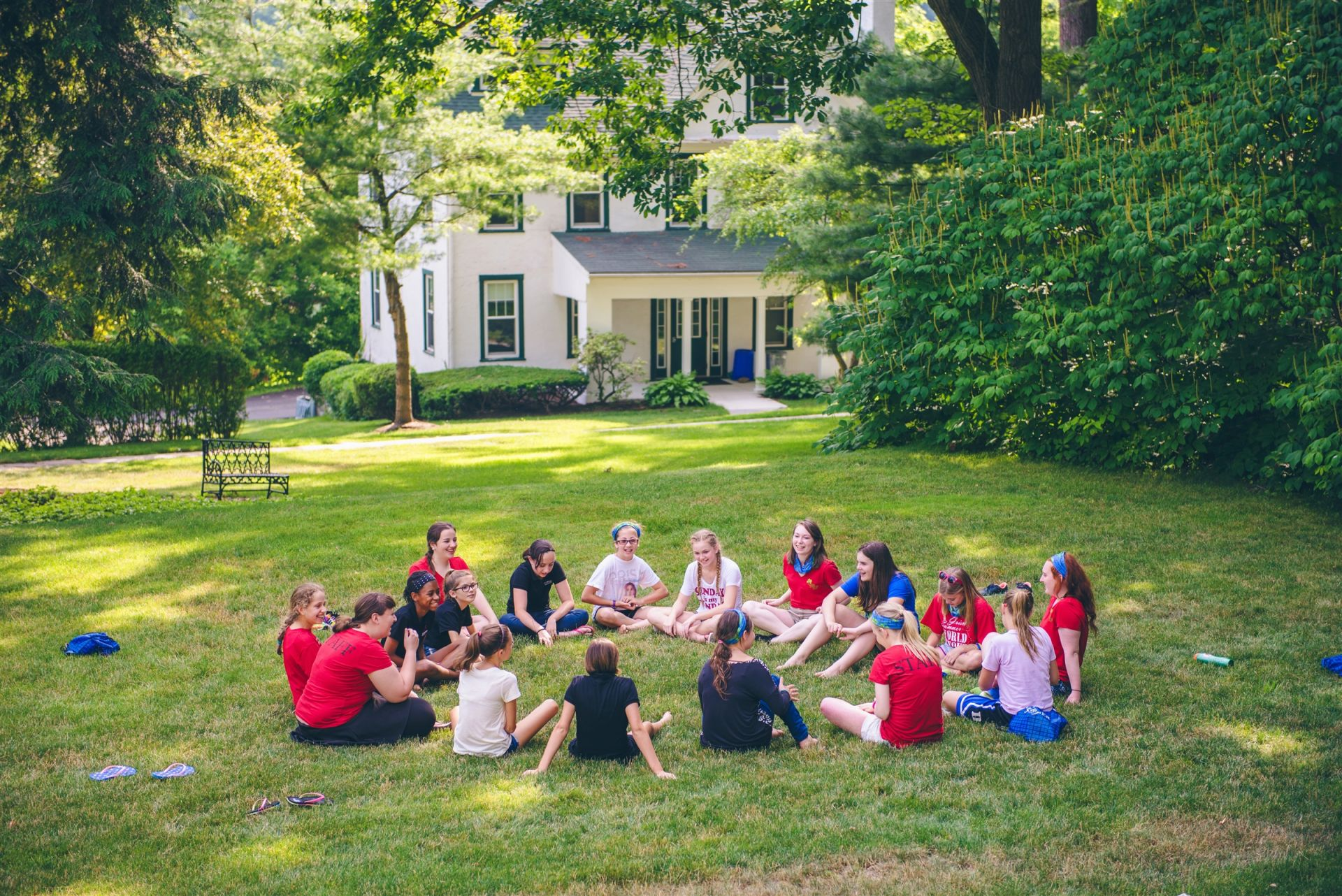 Campers enjoy the shady lawns of campus where they can gather in groups for camp activities.
