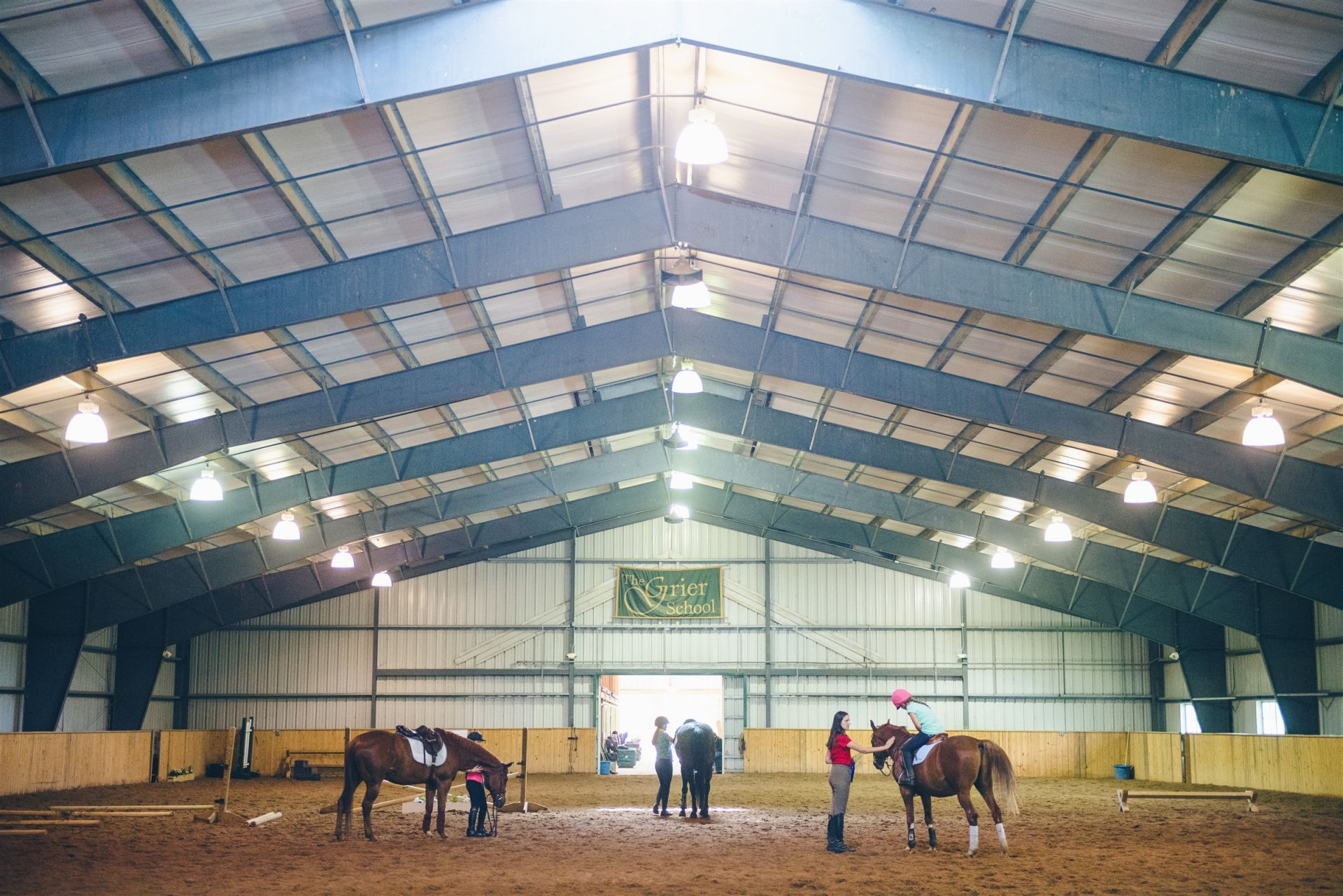 Campers that participate in equestrian activities at Grier use the indoor riding arenas or outdoor riding rings.