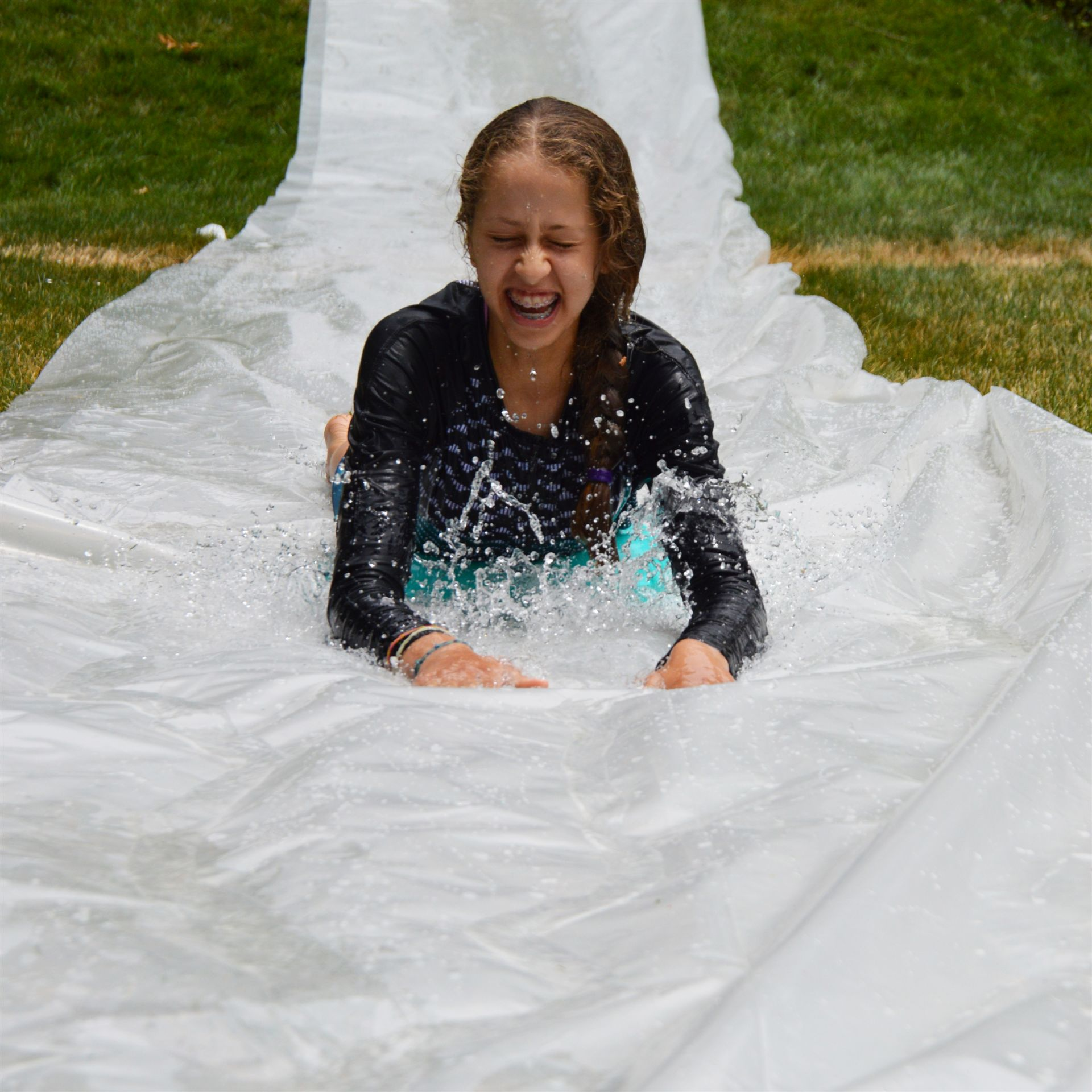 Sliding down a slip-n-slide during a fun Grier Summer event.