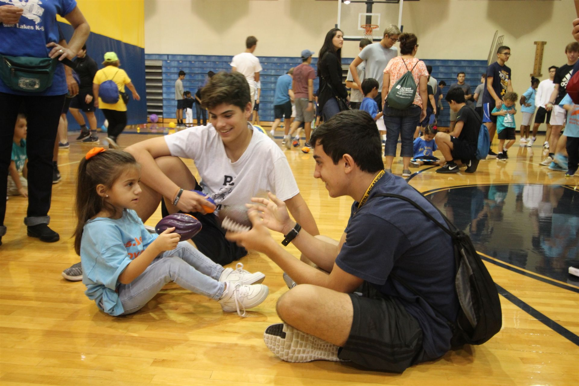 Belen Jesuit students volunteer their time to play with students from Blue Lakes Elementary School during a