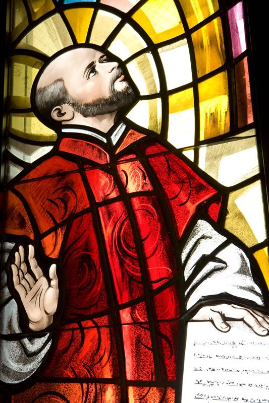 The stained glass window of St. Ignatius of Loyola is found in Our Lady