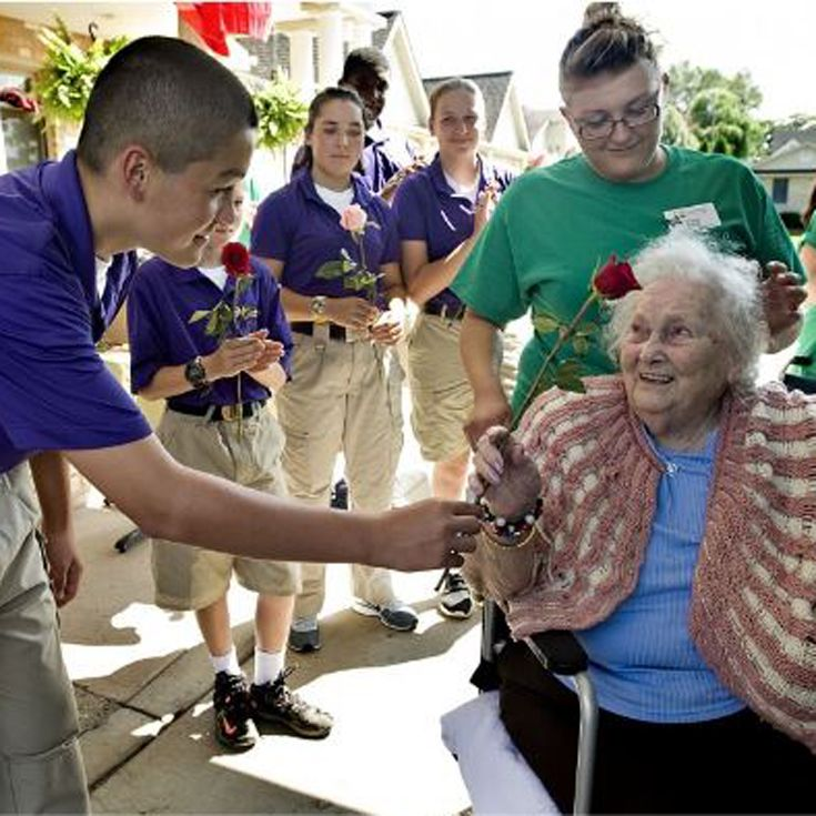 Cadets welcome the residents of Greenfield Nursing Home after the flood.