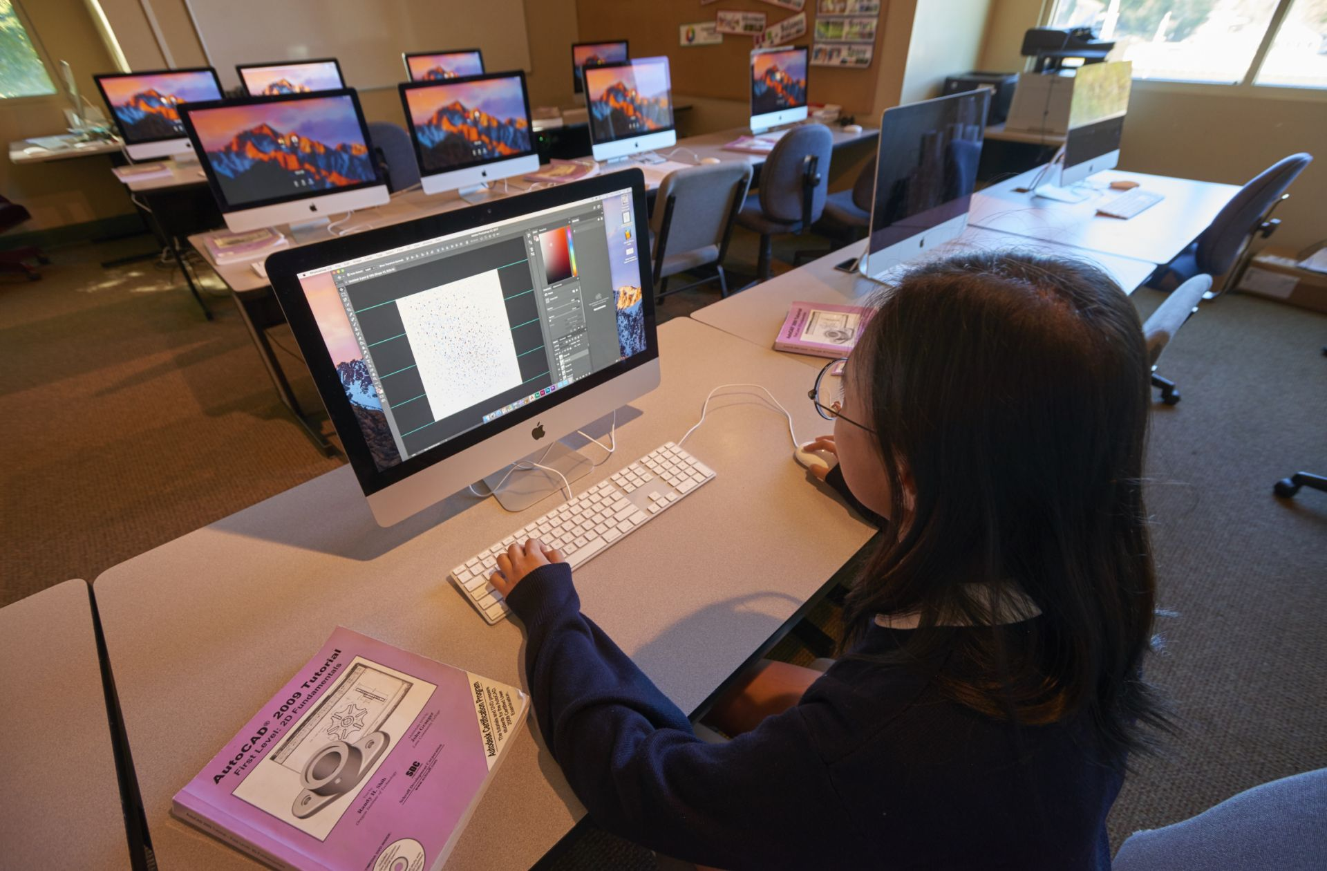 Our lab is full of iMacs and provides space for video, graphic design, and photography classes.