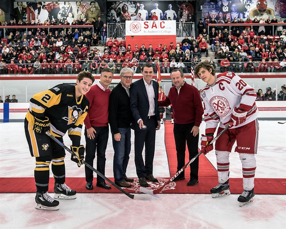 (l-r) Captain of Pittsburgh Penguins, Jack Lipovich; Headmaster Kevin McHenry; Aurora Mayor, Geoff Dawe; Jonathan Thomson '07; Board Chair, Dan Stock; Saints captain, Morgan Barron '17