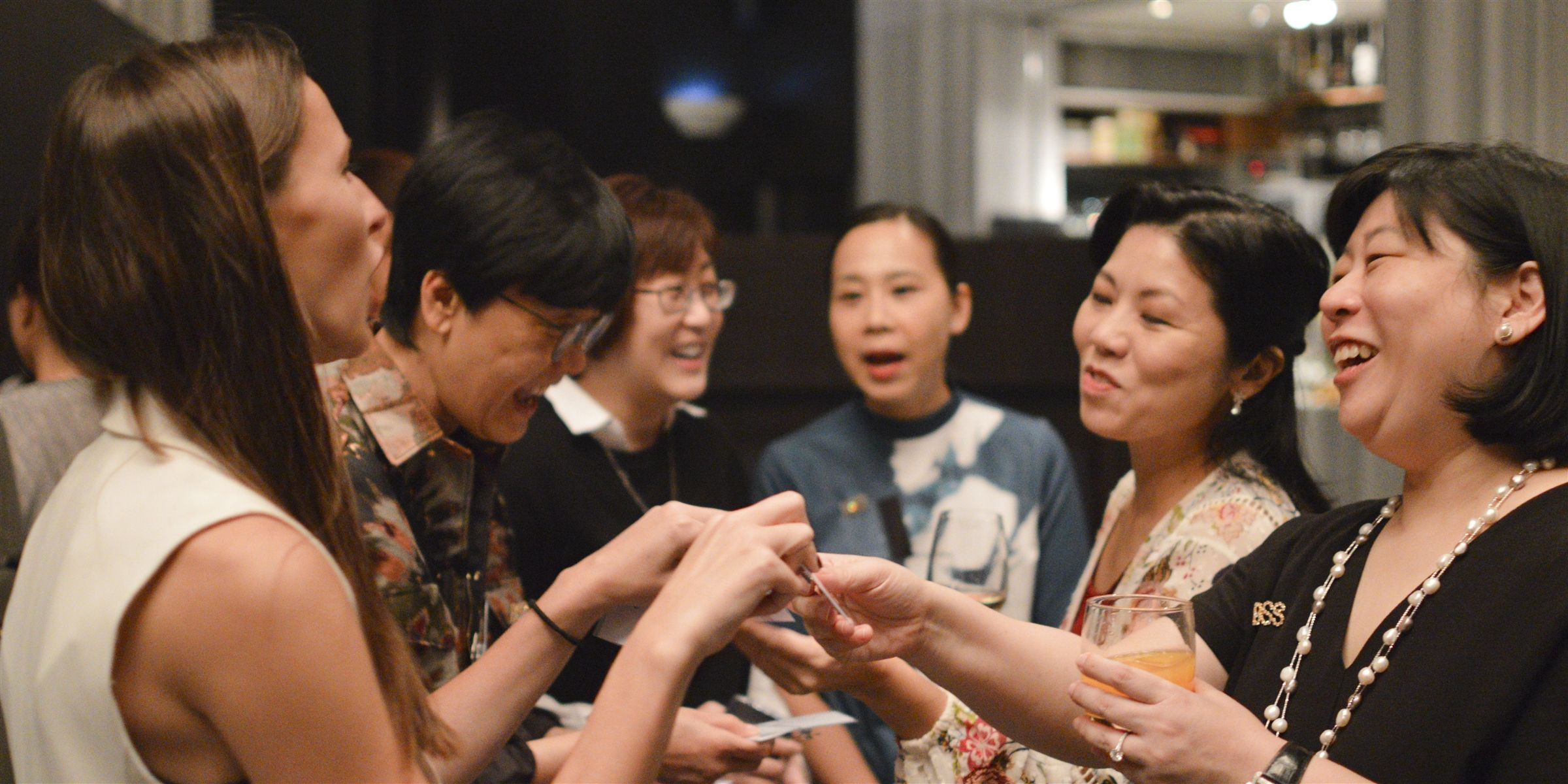 A group of alumnae talk at an event in Hong Kong