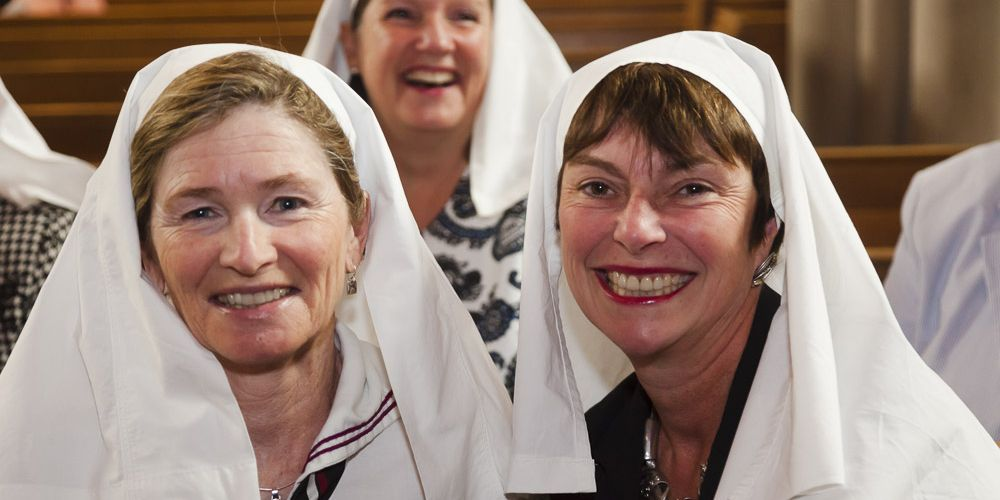 Two women in white veils in the BSS Chapel
