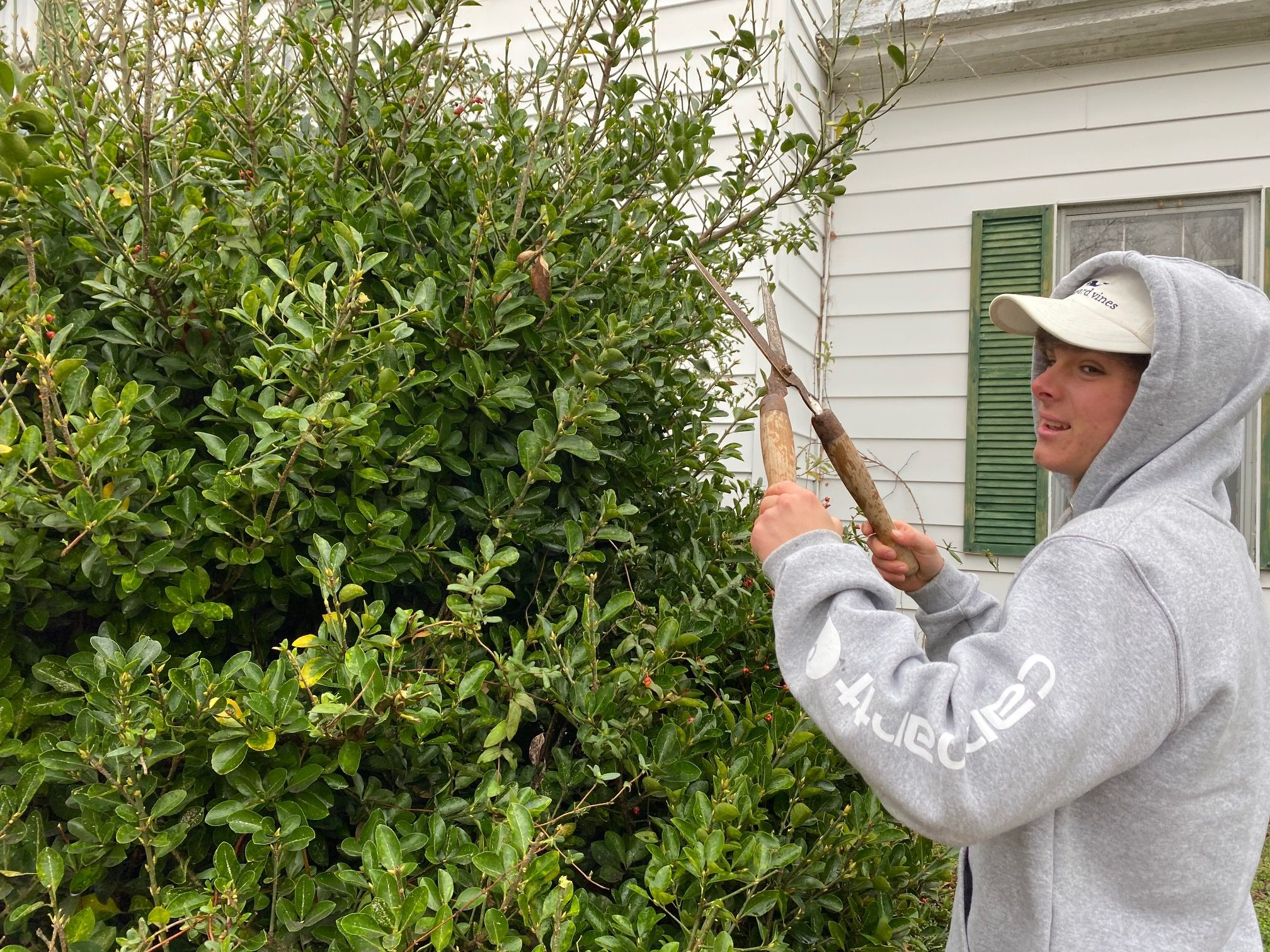 private school boarding school student doing yard work for community service