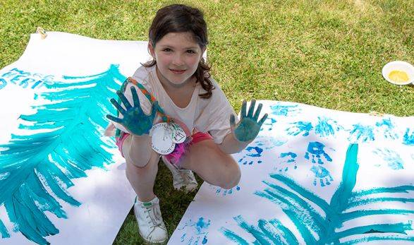 Young camper finger painting