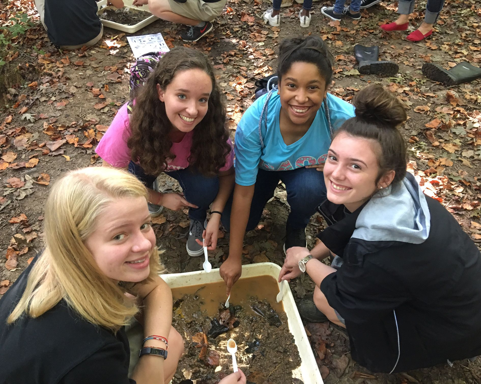 At the Gwinnett Environmental Heritage Center, students cull elements of their excavations. Students integrate this experience with past studies on stream ecology.