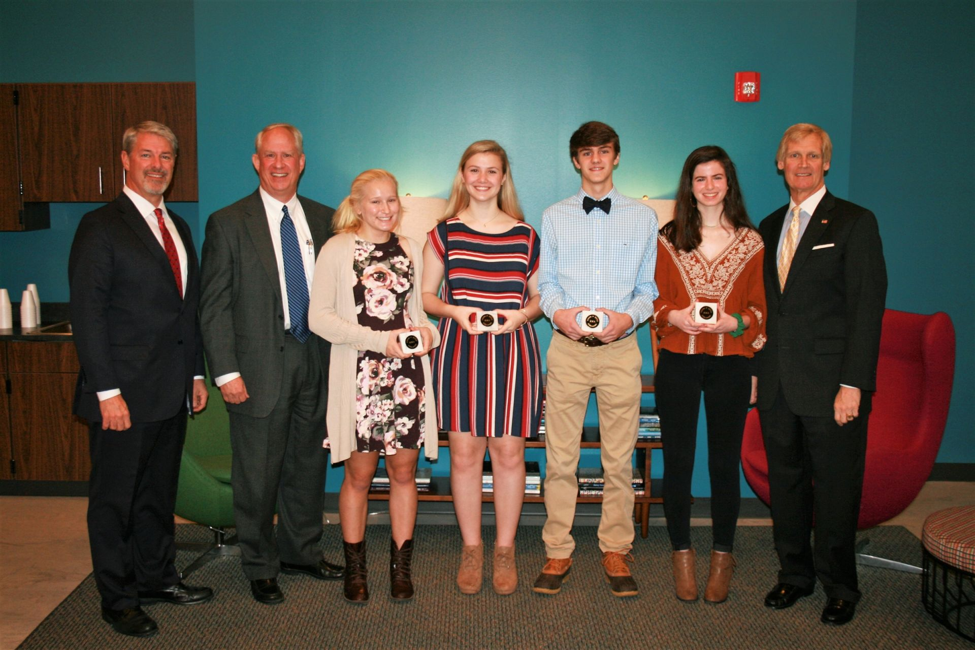 Trustees of the Turner W. Battle Scholarship Jeffrey Batts, Richard Battle, and David Warren, stand with the scholarship recipients.  The 2018-2019 recipients are Haley McCall, Emory Pittman, Colby Freeman, and Georgia Morris  (L to R).