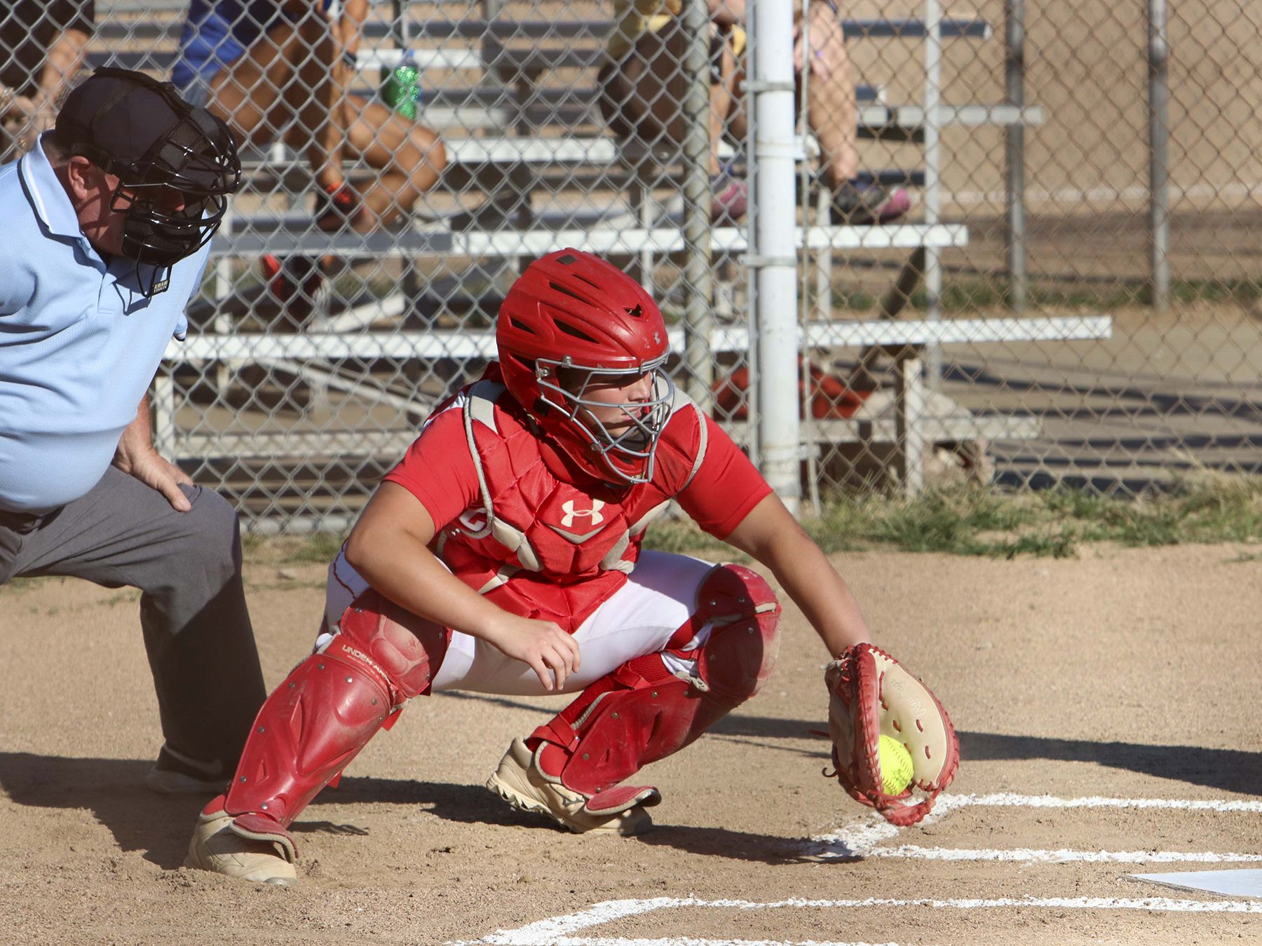 The CJ catcher receives the ball
