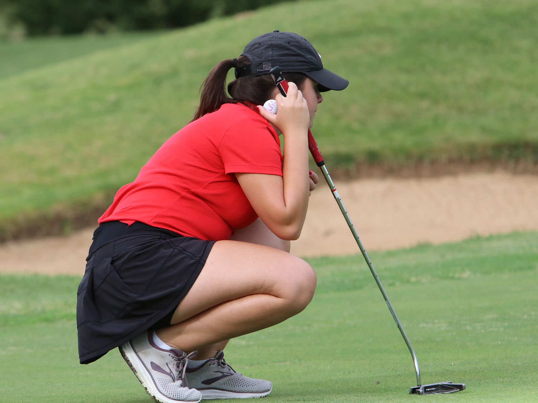 A CJ Golf player lines up her shot