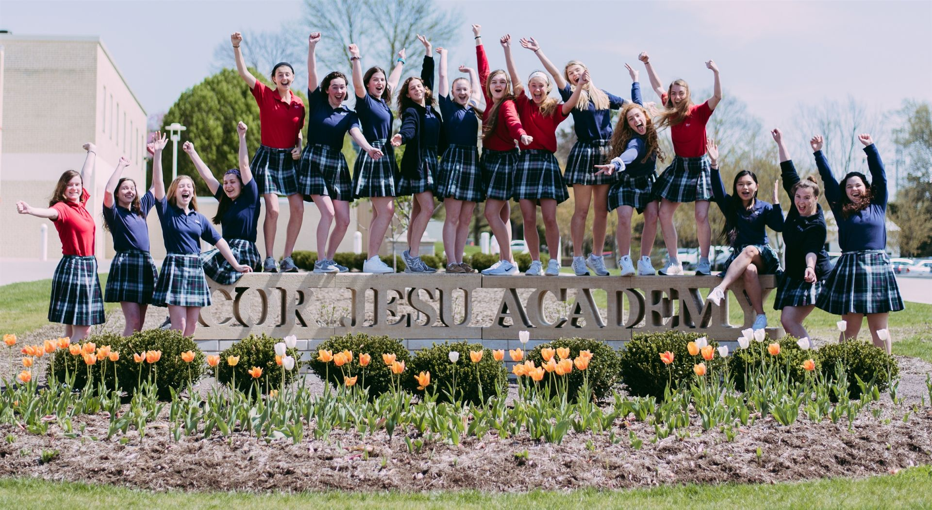 "Students Pose for the Camera at the ""Cor Jesu Academy"" benches"