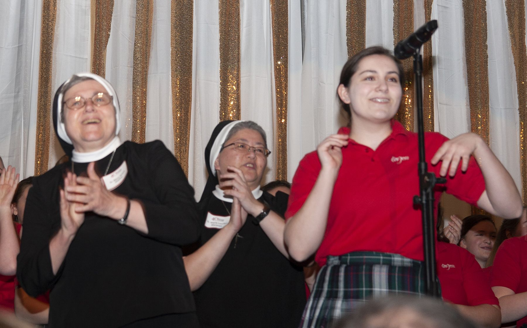 The sisters and a CJ student perform during the 2019 auction fund-a-need