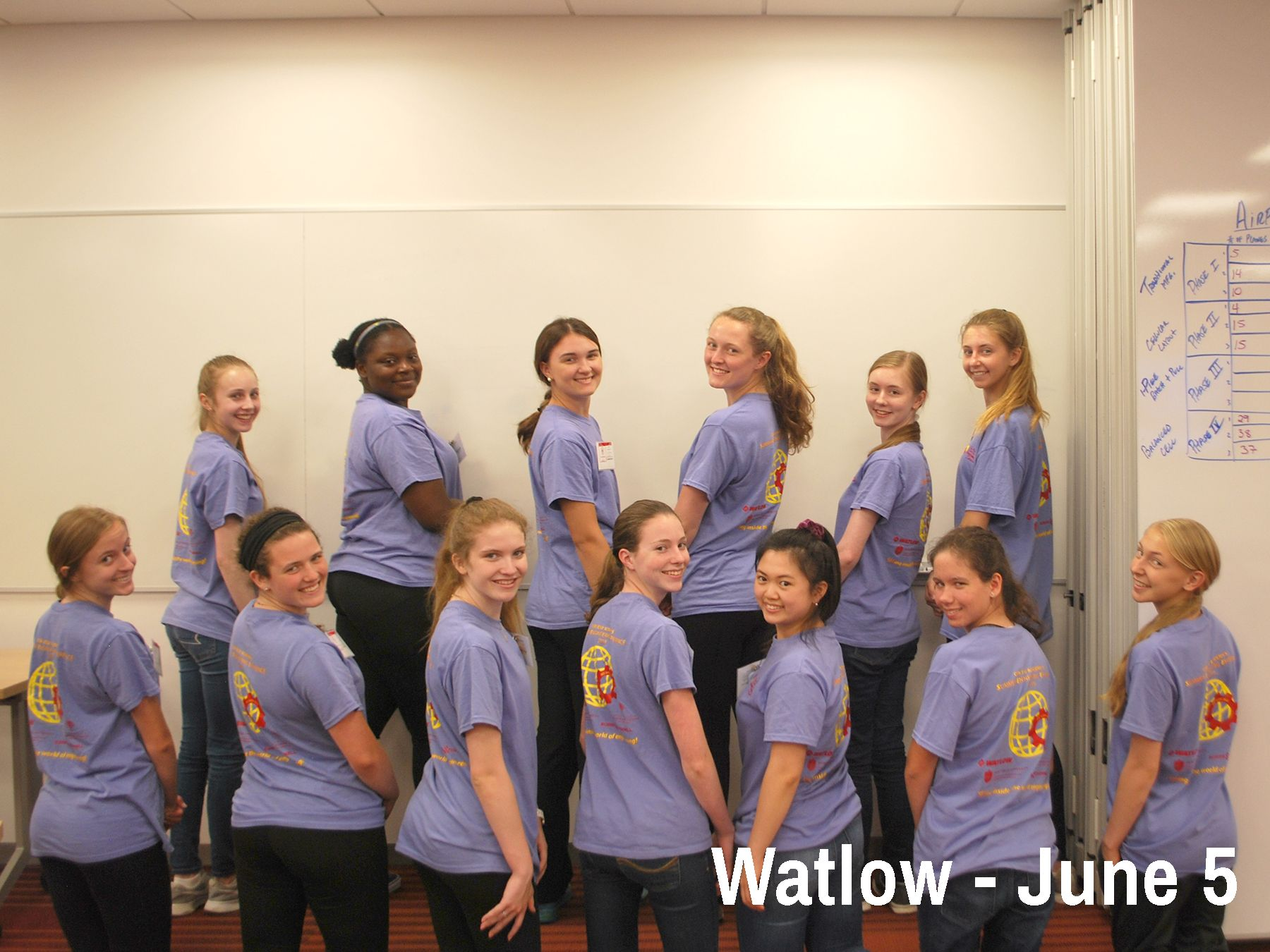 Cor Jesu students show off the SEE T-Shirts while at Watlow