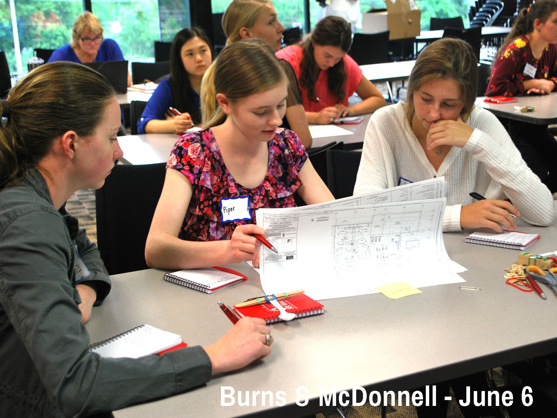 Cor Jesu students study engineering drawings while learning about Engineering Consulting at Burns & McDonnell