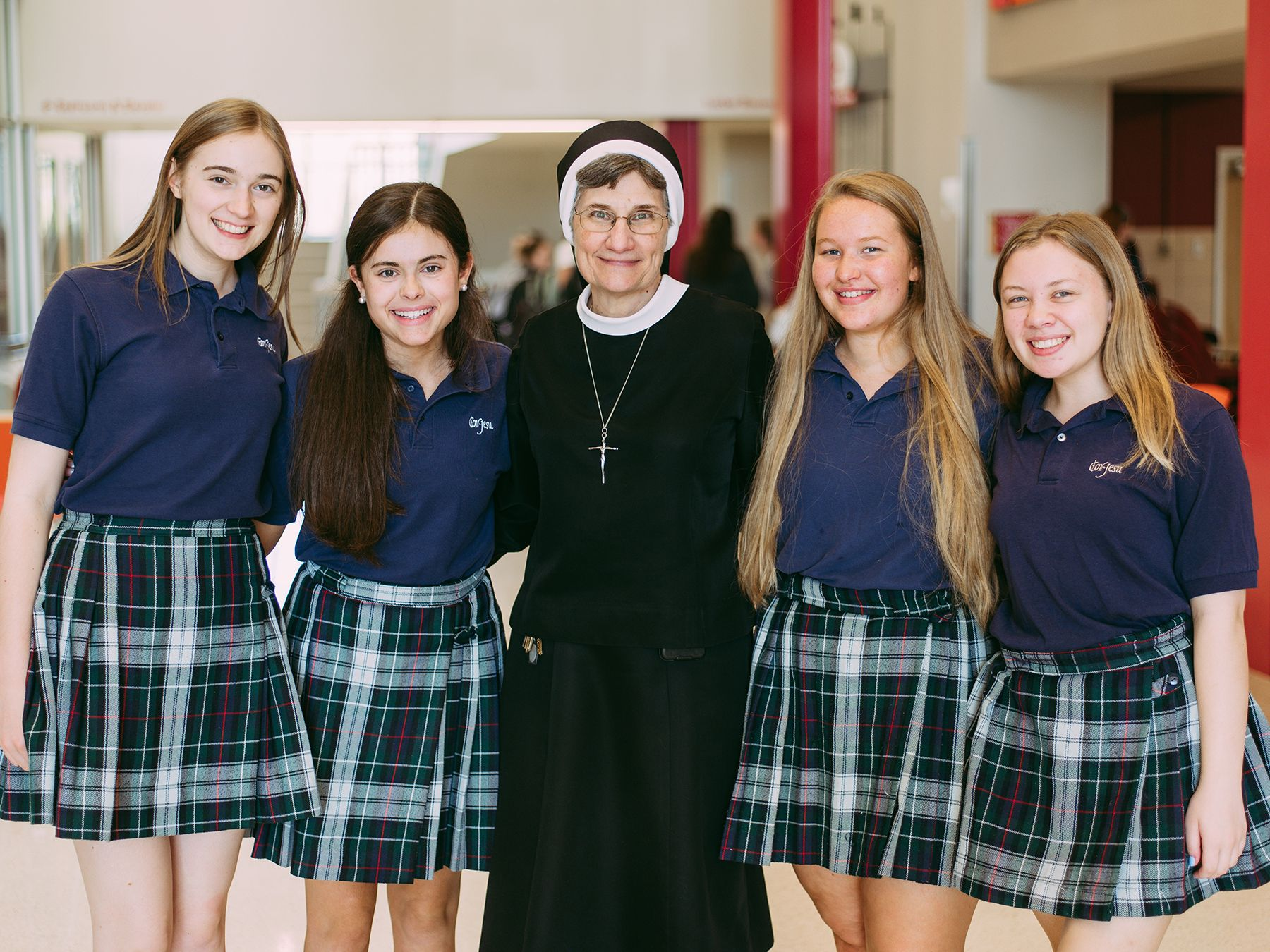 Sr. Veronica Beato poses with Cor Jesu students