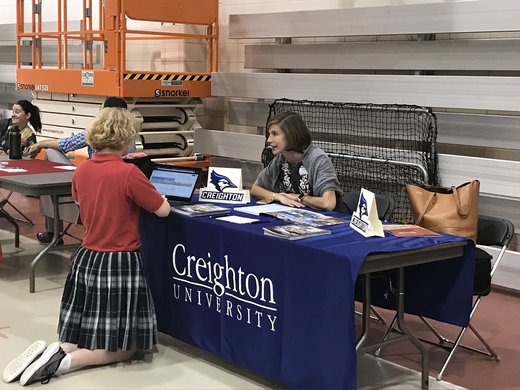 A CJ students signs up during a visit with a rep from Creighton University