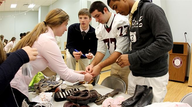 Kids Helping Kids enlists the help of US students to sort and distribute gently used shoes to those in need.