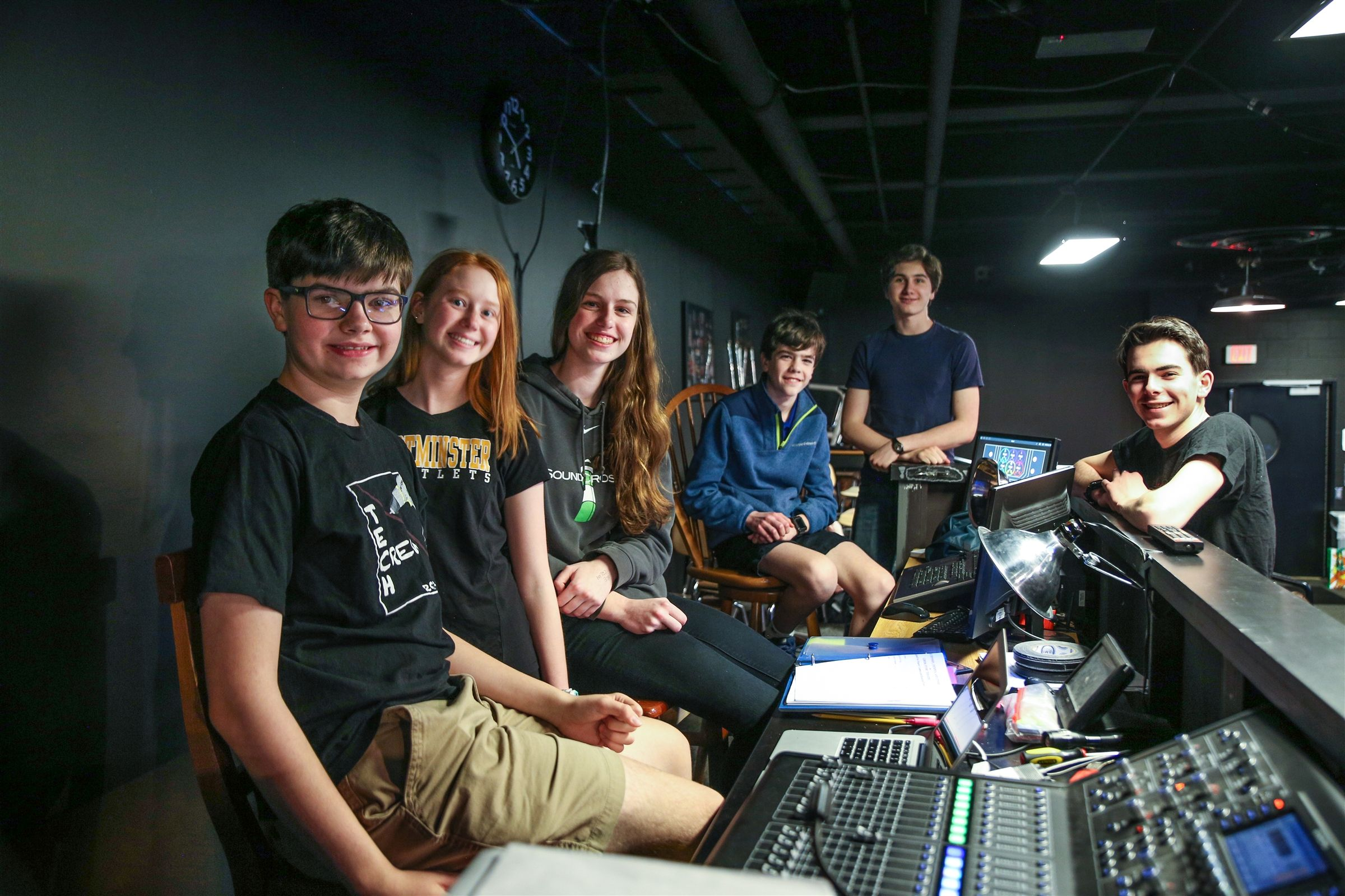 Members of the Tech Crew by the Wyckoff Family Black Box Theater lighting board