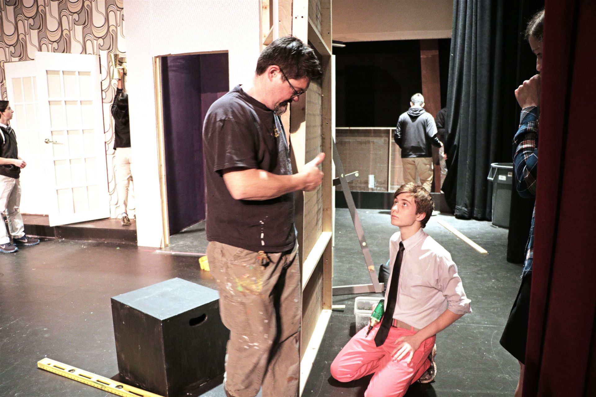 Theatre Tech Director John Conners guides Tech Crew members through their hands-on participation in building the sets