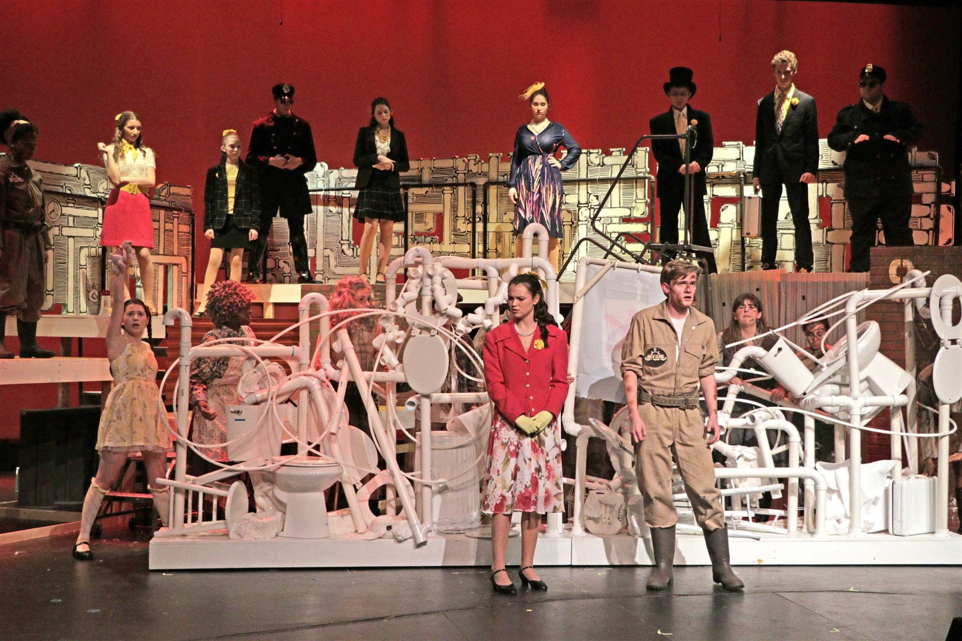 The multi-tier set and large moveable set pieces for Urinetown built by St. Luke's Tech Crew helped accommodate for the many actors in the production