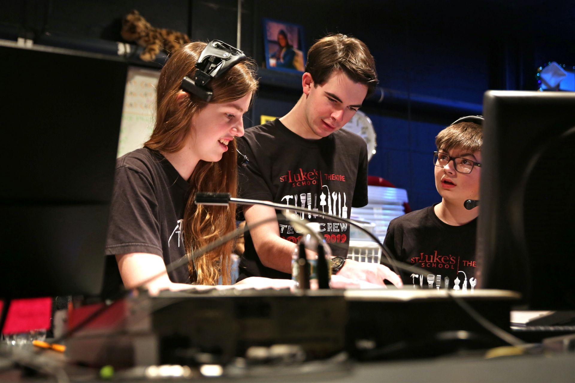 Students of the Tech Crew working in the tech booth