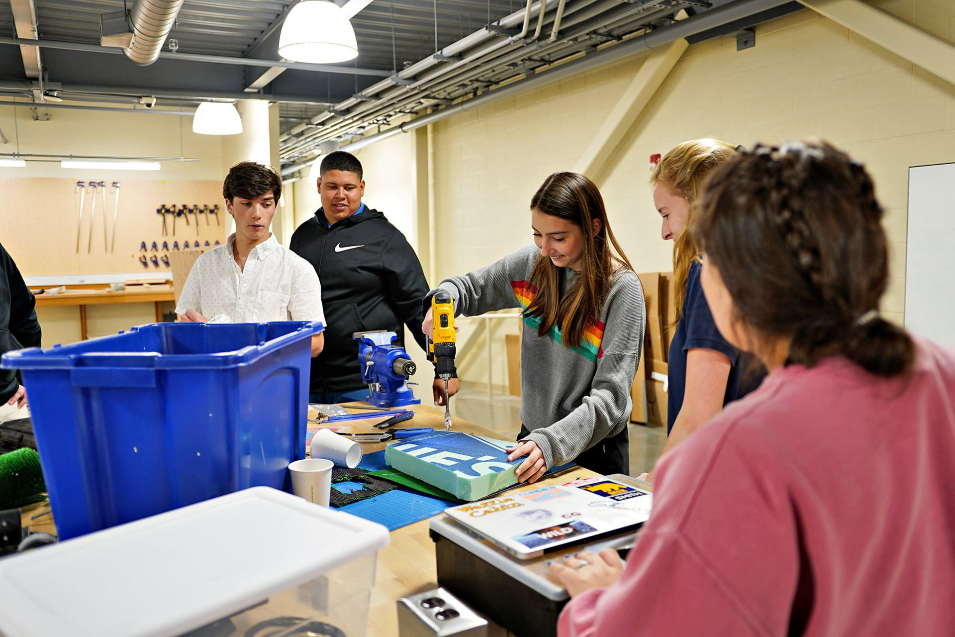 Students use power drills to construct project in designLab.