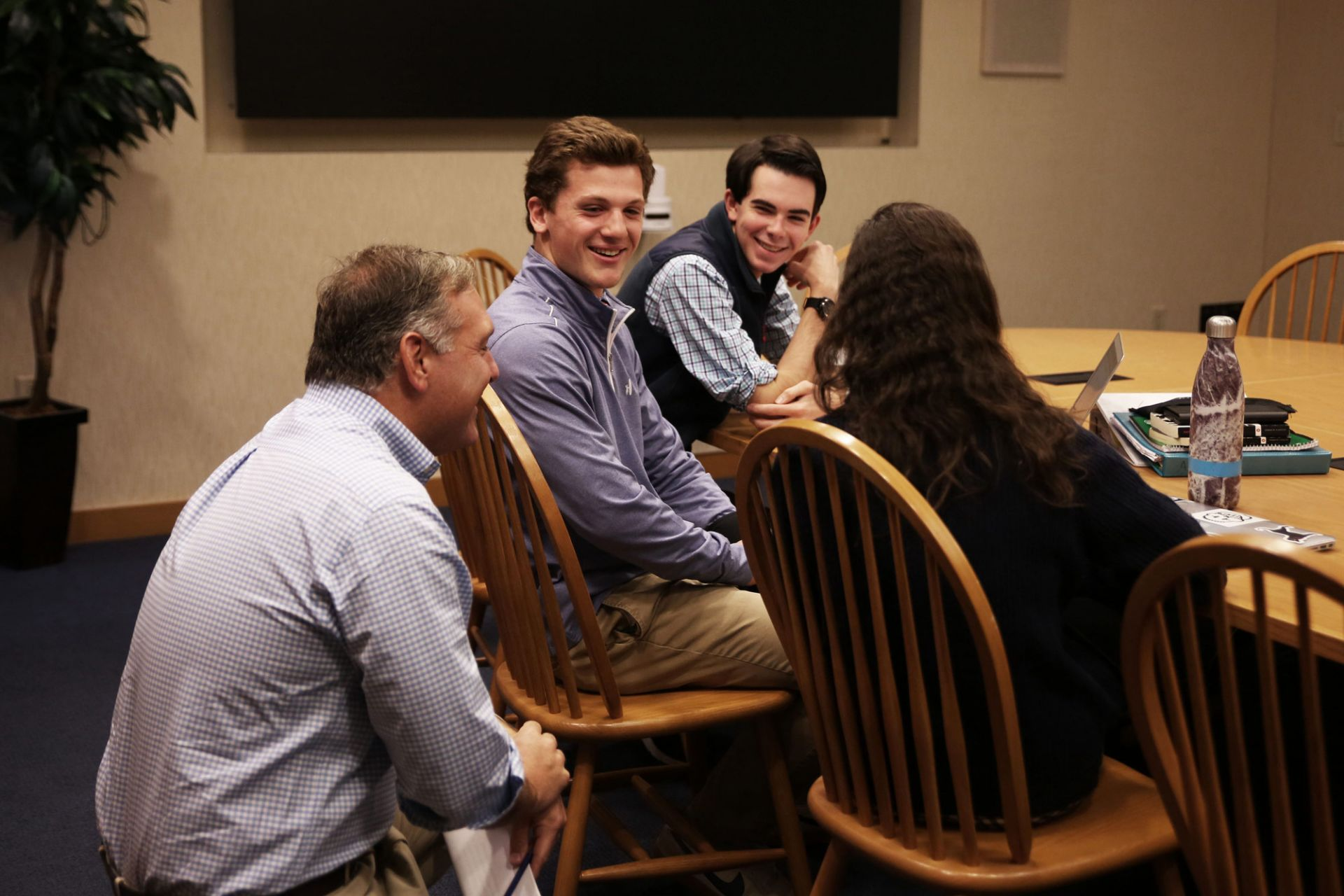 Mike Gaumer, President of Vineyard Vines, listens to a team's concept