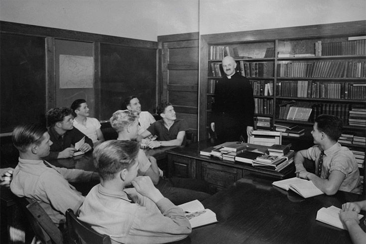 Father William M. Chapin in the classroom