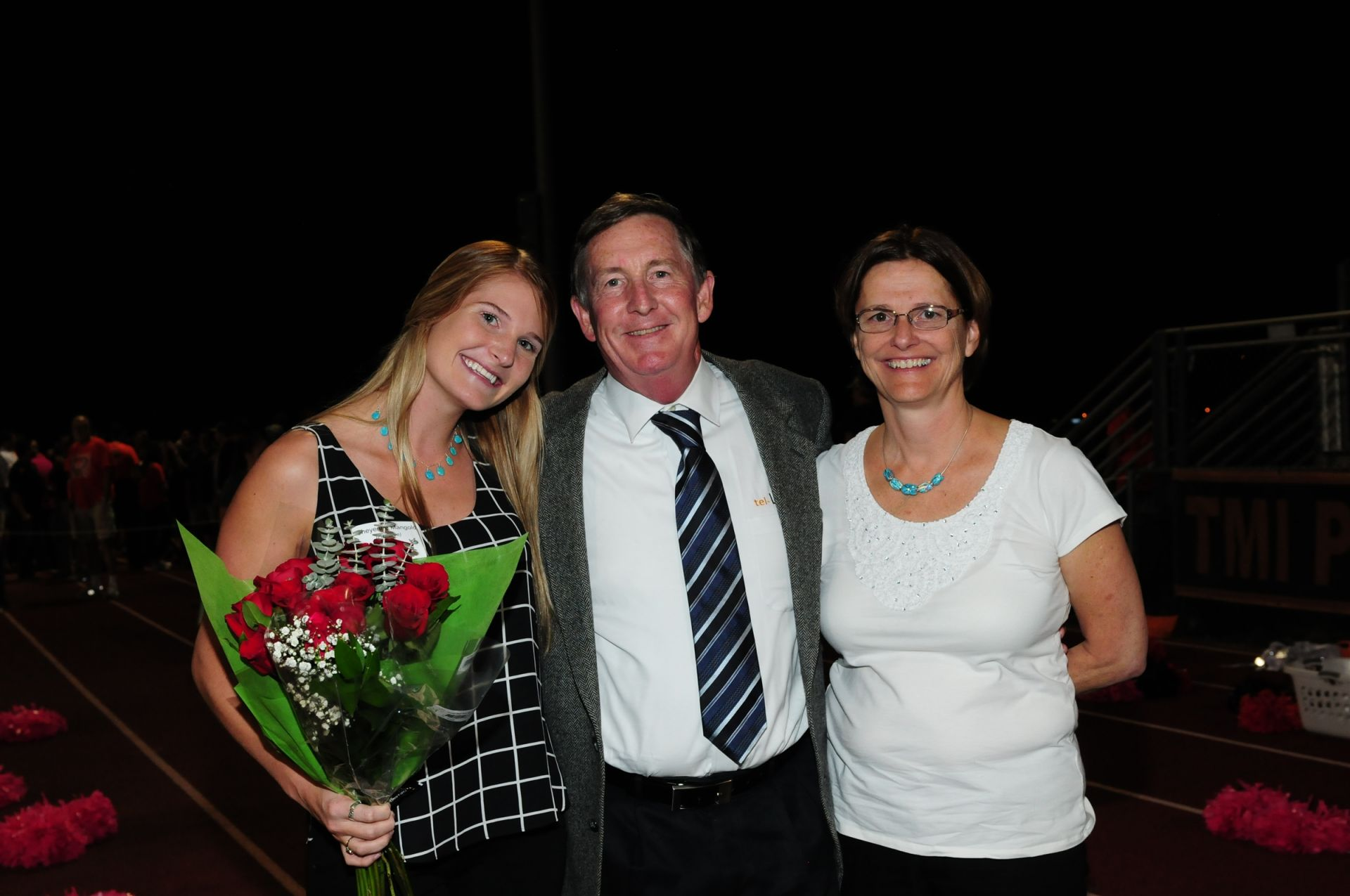 Cheyenne Mangold '07 parents Andrew and Laurie on field 2015