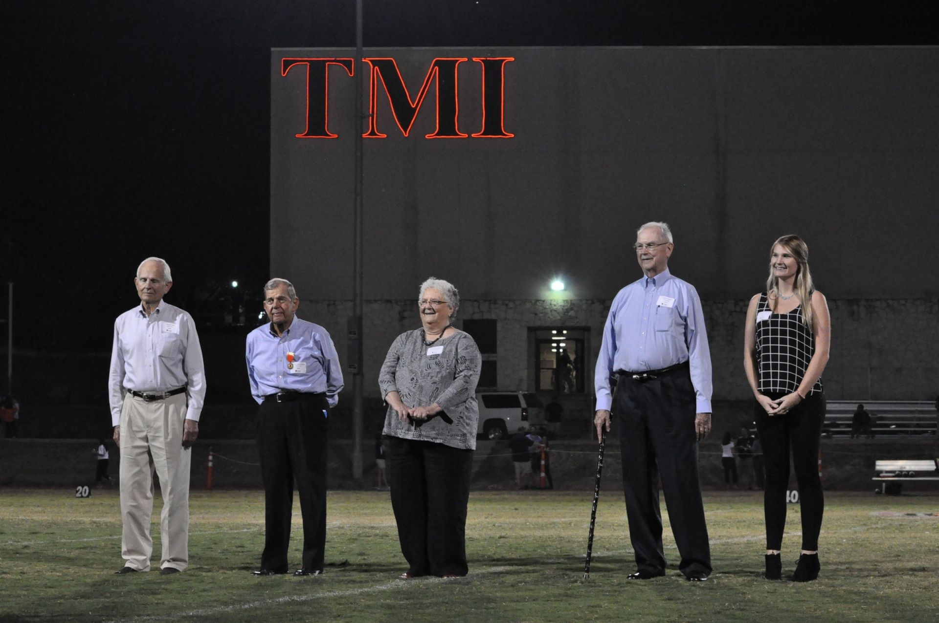 Hall of Fame honorees on Homecoming game field