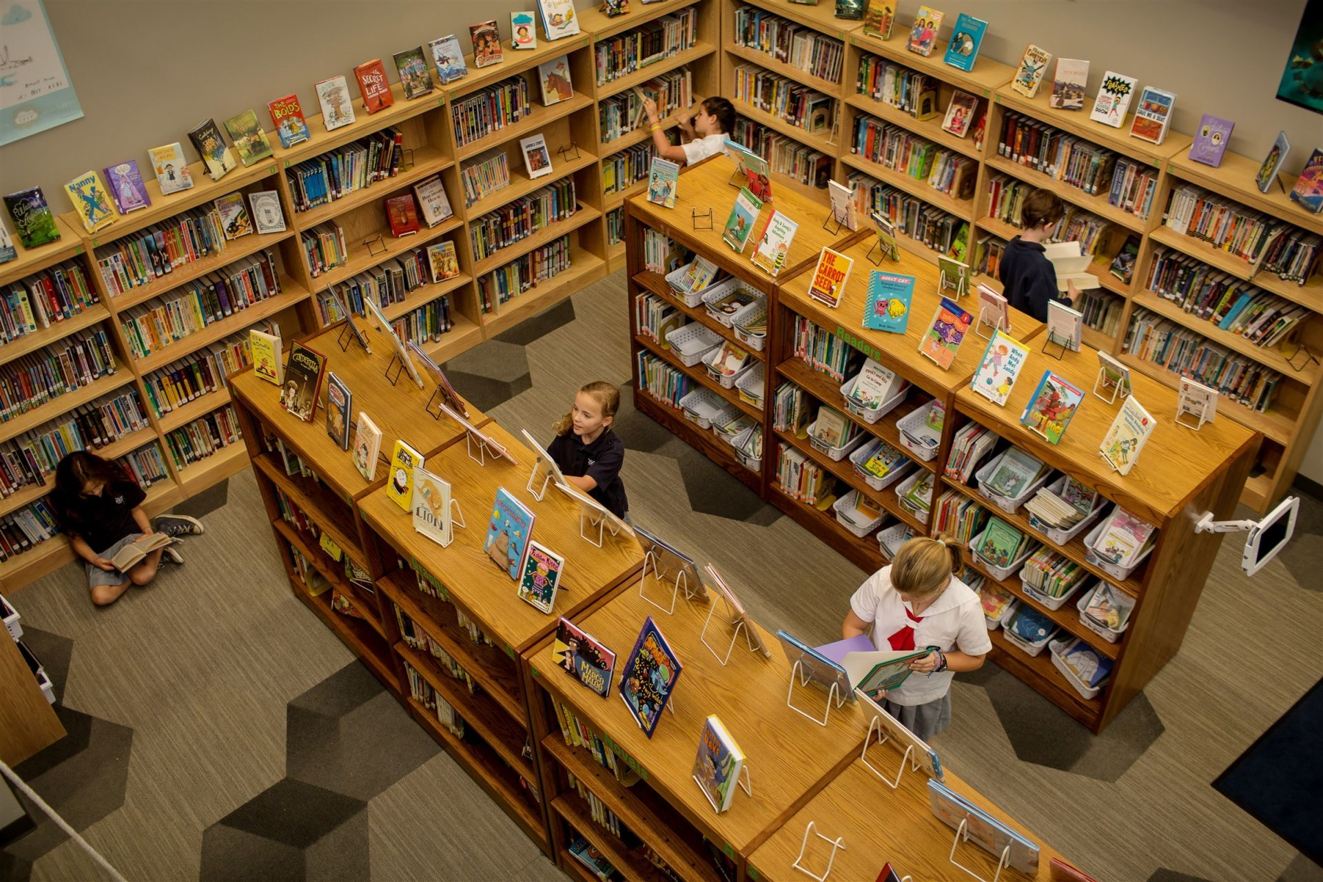 Students can follow their own interests in the Discovery Center library.